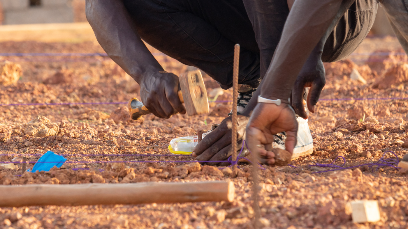 Burkina Faso Team Member Installing Foundations Markers Photo By Kr Architecture